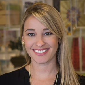 Carrie DeVries, APR and PR Division Lead at DEVENEY