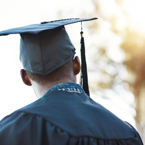 College graduate looking towards his future to showcase the DEVENEY Higher Education Practice Area